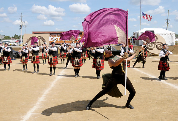 Don Knight | The Herald Bulletin<br /> Color guard member Cené Dyson performs with the Anderson High School Marching Highlanders at State Fair Band Day on Saturday.