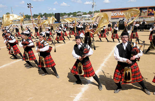 "Don Knight | The Herald Bulletin<br /> The Anderson High School Marching Highlanders perform their show ""Celtic Runes: Mind, Body, Spirit"" at State Fair Band Day on Saturday."