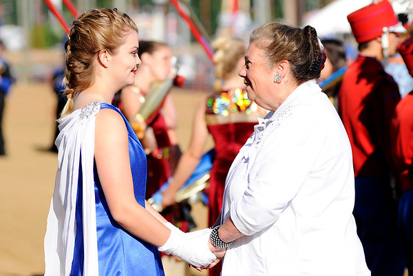 Don Knight | The Herald Bulletin<br /> Elwood band director Paula Simmons encourages drum major Kaylee Alfrey as she talks to each of her students before their performance at State Fair Band Day on Saturday.