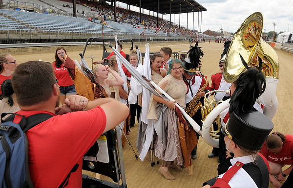Don Knight   The Herald Bulletin<br /> Frankton celebrates after performing at State Fair Band Day on Saturday.
