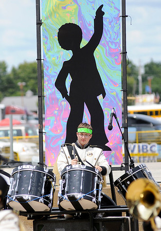 Don Knight | The Herald Bulletin<br /> Percussionist Blake Riggins performs with the Lapel Marching Bulldogs at State Fair Band Day on Saturday.