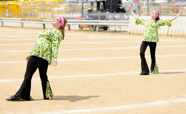 """Don Knight   The Herald Bulletin<br /> The Marching Bulldogs color guard dances to hits from Queen during the band's """"Bohemian Rhapsody"""" show at State Fair Band Day on Saturday."""