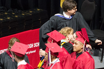 (detail): In line for his diploma, Noah receives a congratulatory hug from English teacher and drama director Mrs Kelly O'Connor -- Noah Friedlander - June 6, 2017 graduation from Montgomery Blair High School - Magnet Program for Math, Science, and Computer Science, Xfinity Center, University of Maryland, College Park.