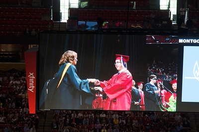 Alex Coy receives his diploma (cover) from Mrs. Johnson -- Noah Friedlander - June 6, 2017 graduation from Montgomery Blair High School - Magnet Program for Math, Science, and Computer Science, Xfinity Center, University of Maryland, College Park.