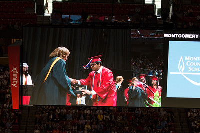 Sambuddha Chattopadhyay receives his diploma (cover) from Mrs. Johnson -- Noah Friedlander - June 6, 2017 graduation from Montgomery Blair High School - Magnet Program for Math, Science, and Computer Science, Xfinity Center, University of Maryland, College Park.