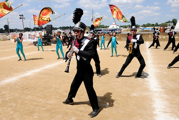 "Don Knight | The Herald Bulletin<br /> The Marching Tigers perform their show ""Magical Mystery Tour"" at State Fair Band Day on Friday."