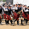 Don Knight | The Herald Bulletin<br /> The Marching Highlanders wave to the crowd as they walk off the field at State Fair Band Day on Friday. Anderson finished first in their division in the day show.