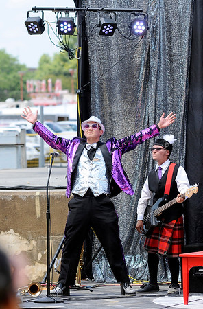 Don Knight | The Herald Bulletin<br /> Samuel Eskew emerges on Stage as Elton John in Anderson's State Fair Band Day performance on Friday.