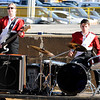 "Don Knight | The Herald Bulletin<br /> Hannah Smith on bass and Gideon Hahn on drums as Frankton performs their show ""A Million Dreams"" at State Fair Band Day on Friday."