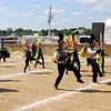 Don Knight | The Herald Bulletin<br /> The Lapel Band dances the Funky Chicken as they walk off the field during State Fair Band Day on Friday.