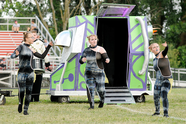 "Don Knight | The Herald Bulletin<br /> Lapel color guard members exit a space ship during their show ""Alien Invastion"" at the Tartan Tournament of Bands at Highland Middle School on Friday."