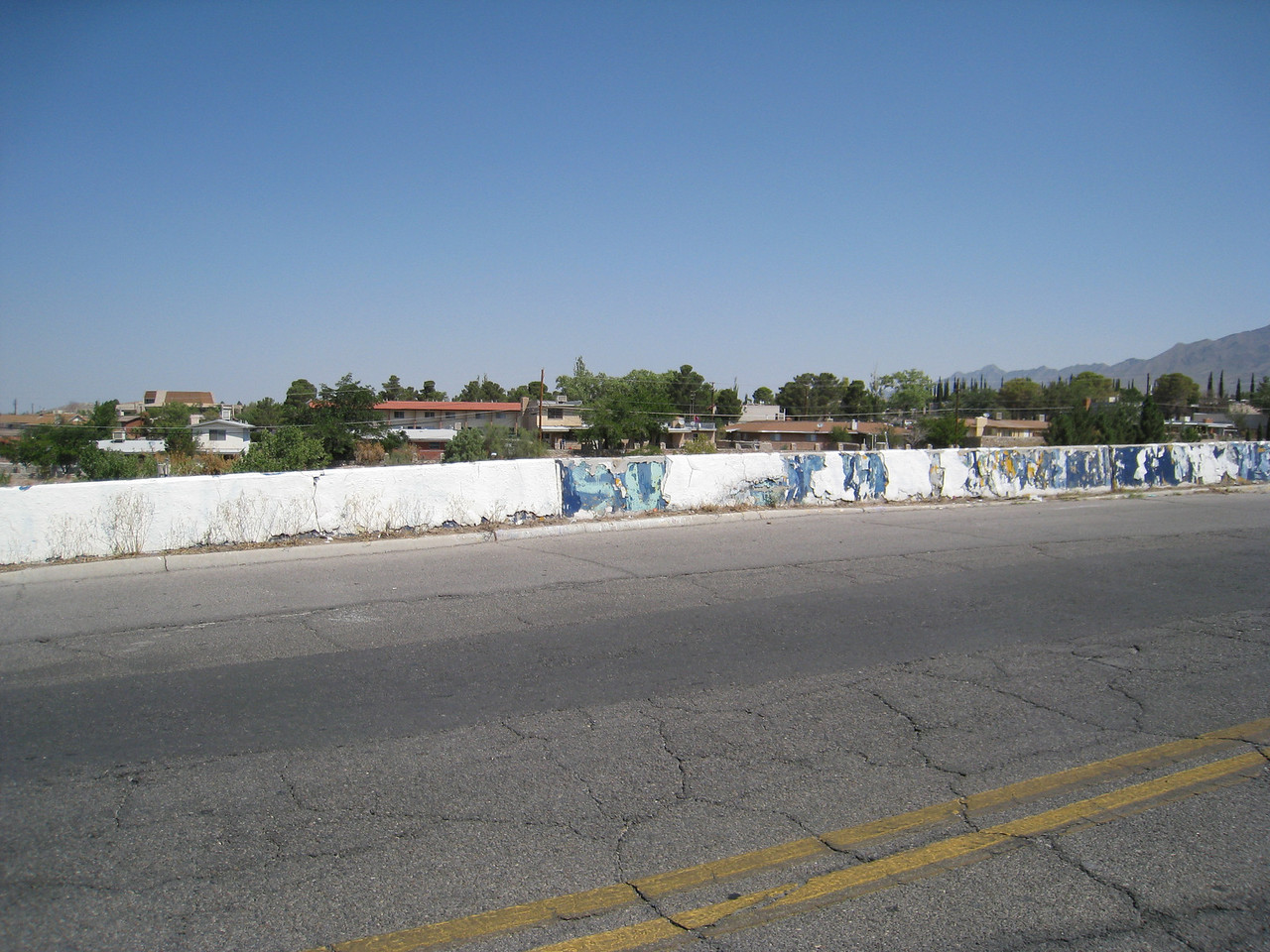 The famous wall across the street from Coronado. It has had many layers of paint over the years.