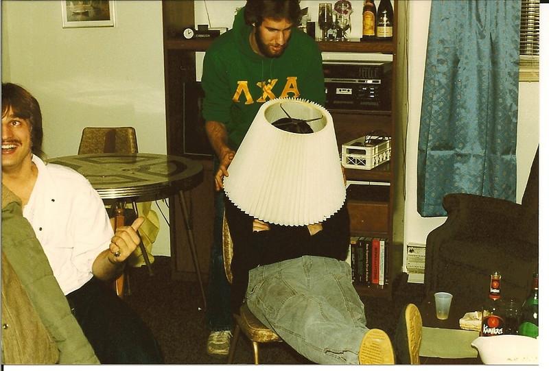 Hootmonster lampshades Hammer while JC looks on - November '86