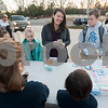 Kristen Courtney, center, buys a carton of eggs before school from All Saints Episcopal School first graders that they collected from their learning farm on Thursday Feb. 1, 2018. The students named their business Egg World.<br /> <br /> (Sarah A. Miller/Tyler Morning Telegraph)