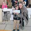 Nash Jones, 7, poses with his mom Amanda Jones and a carton of eggs before school on Thursday Feb. 1, 2018. First graders from All Saints Episcopal School collected eggs from their learning farm to sell. The students named their business Egg World.<br /> <br /> (Sarah A. Miller/Tyler Morning Telegraph)
