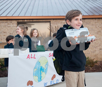 Nash Jones, 7, poses with a carton of eggs before school  on Thursday Feb. 1, 2018. First graders from All Saints Episcopal School collected eggs from their learning farm to sell. The students named their business Egg World.  (Sarah A. Miller/Tyler Morning Telegraph)