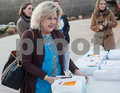 Teacher Robin Lewis buys a carton of eggs before school on Thursday Feb. 1, 2018. First graders from All Saints Episcopal School collected eggs from their learning farm to sell. The students named their business Egg World.  (Sarah A. Miller/Tyler Morning Telegraph)