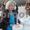Teacher Robin Lewis buys a carton of eggs before school on Thursday Feb. 1, 2018. First graders from All Saints Episcopal School collected eggs from their learning farm to sell. The students named their business Egg World.<br /> <br /> (Sarah A. Miller/Tyler Morning Telegraph)