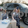 Katie Giordano, 7, and Sydney Macha, 6, take an order for eggs from a car in the drop-off lane at All Saints Episcopal School in Tyler on Thursday Feb. 1, 2018. First graders from All Saints Episcopal School collected eggs from their learning farm to sell. The students named their business Egg World.<br /> <br /> (Sarah A. Miller/Tyler Morning Telegraph)