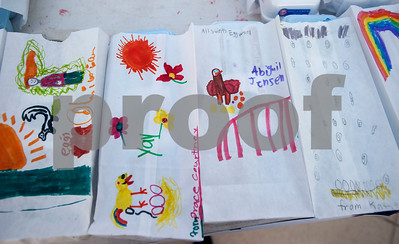 All Saints Episcopal School first graders decorated bags for cartons of eggs from their learning farm that they sold to parents and teachers before school on Thursday Feb. 1, 2018. The students named their business Egg World.  (Sarah A. Miller/Tyler Morning Telegraph)
