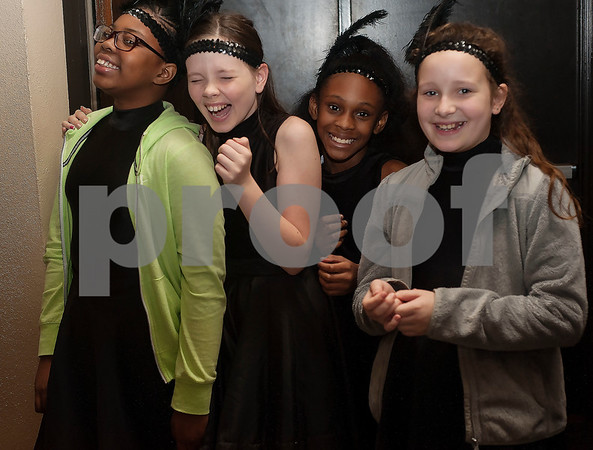 Caldwell Elementary School dancers Taniya Green, 11, Addison Dixon, 11, Shaylin Perkins, 11, and Hunter Ransome, 10, wait to take the stage to perform with the The East Texas Symphony Orchestra during their annual Link Up concert at Caldwell Auditorium on Tuesday Feb. 13, 2018. Over 3,400 fourth and fifth grade students from TISD and other schools attended the concert.   (Sarah A. Miller/Tyler Morning Telegraph)