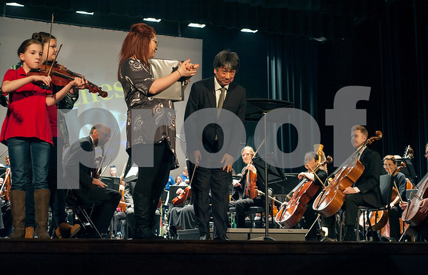 East Texas Symphony Orchestra director and conductor Richard Lee bows as he takes the stage during the annual Link Up concert at Caldwell Auditorium on Tuesday Feb. 13, 2018. Over 3,400 fourth and fifth grade students from TISD and other schools attended the concert.   (Sarah A. Miller/Tyler Morning Telegraph)