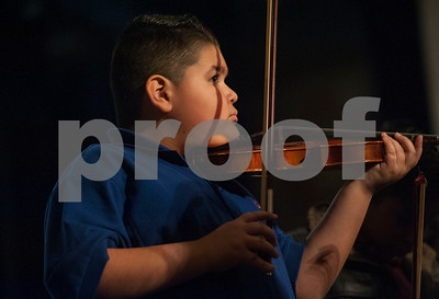 Clarkson Elementary School student Ian Morales, 9, plays violin on stage with his classmates and the East Texas Symphony Orchestra during the annual Link Up concert at Caldwell Auditorium on Tuesday Feb. 13, 2018. Over 3,400 fourth and fifth grade students from TISD and other schools attended the concert.   (Sarah A. Miller/Tyler Morning Telegraph)