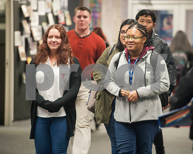 Robert E. Lee High School students Madison Hysell and Idara Imoh walk to the library for a surprise announcement that they are among the six Robert E. Lee High School students receiving a UT Tyler Presidential Fellow Scholarship.  (Sarah A. Miller/Tyler Morning Telegraph)