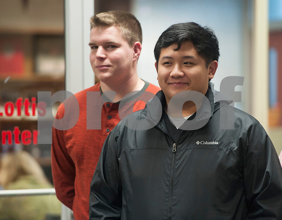 Robert E. Lee High School students Kaleb Hill and Kyle Ferrer arrive to the library on Tuesday Feb. 13, 2018 for a surprise announcement that they are among the six Robert E. Lee High School students receiving a UT Tyler Presidential Fellow Scholarship.  (Sarah A. Miller/Tyler Morning Telegraph)
