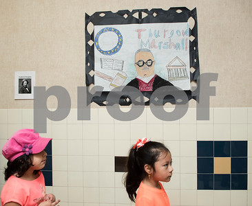 Clarkson Elementary School students walk past a drawing of Thurgood Marshall during the Black History Living Museum at the school Friday Feb. 17, 2017. More than 70 students participated in the event, dressing in costume as historic African Americans and reciting short speeches to their peers and visitors at the school.  (Sarah A. Miller/Tyler Morning Telegraph)