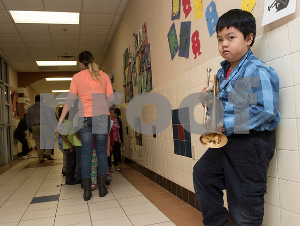 Clarkson Elementary School student Joseph Huynh, 8, portrays musician Luis Armstrong during the Black History Living Museum at the school Friday Feb. 17, 2017. More than 70 students participated in the event, dressing in costume as historic African Americans and reciting short speeches to their peers and visitors at the school.  (Sarah A. Miller/Tyler Morning Telegraph)