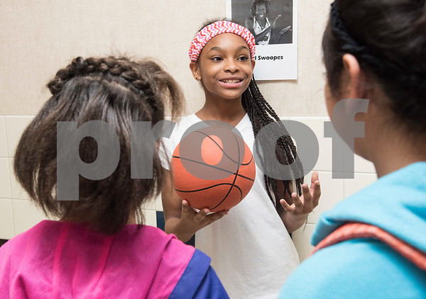 Clarkson Elementary School student Daniela Hawkins, 11, recites her speech as Sheryl Swoopes, the first player to be signed by the Women's National Basketball Association during the Black History Living Museum at the school Friday Feb. 17, 2017. More than 70 students participated in the event, dressing in costume as historic African Americans and reciting short speeches to their peers and visitors at the school.  (Sarah A. Miller/Tyler Morning Telegraph)