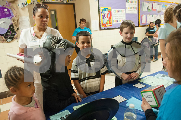 """Students Ny'Tyalia Austin, 5, X'Zayviier Austin, 8, Brandon Young, 8, and Christian Story, 9, play a reading game with teacher Sharon Troxell during Math and Reading Night at Clarkston Elementary School Thursday Feb. 18, 2016. The event was Star Wars themed and featured math and reading game stations for students grades pre-kindergarten through fifth grade. """"The event helps the parents learn strategies to help their kids at home with math and reading,"""" event organizer Shannon Johnson said.   (Sarah A. Miller/Tyler Morning Telegraph)"""