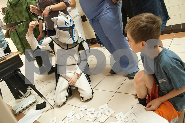 """Student Christian Story, 9, left, plays a math game dressed as a clone trooper during Math and Reading Night at Clarkston Elementary School Thursday Feb. 18, 2016. The event was Star Wars themed and featured math and reading game stations for students grades pre-kindergarten through fifth grade. """"The event helps the parents learn strategies to help their kids at home with math and reading,"""" event organizer Shannon Johnson said.   (Sarah A. Miller/Tyler Morning Telegraph)"""