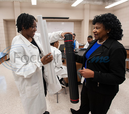 LaTerrian Wiley and Dr. Glendora Carter pack research posters during class on Monday Feb. 18, 2019. Seven Jarvis Christian College students will travel this week to Washington, D.C. to present their research on finding a cure for cancer at the Emerging Researchers National Conference.  (Sarah A. Miller/Tyler Morning Telegraph)