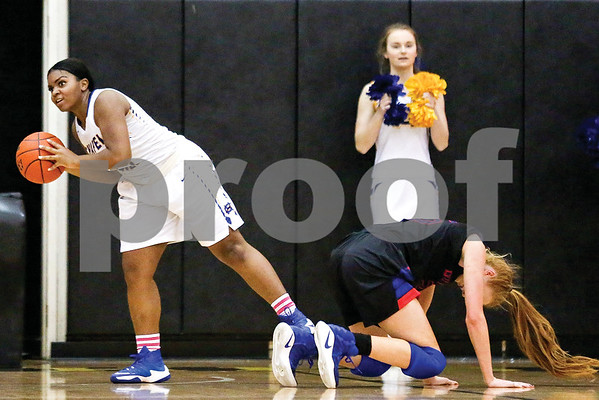 Chapel Hill senior April Walker (15) retrieves the ball and looks to pass during a regional quarterfinals girls basketball game at Wagstaff Gymnasium in Tyler, Texas, on Monday, Feb. 20, 2017. The Bullard Lady Panthers beat the Chapel Hill Lady Bulldogs 54-36. (Chelsea Purgahn/Tyler Morning Telegraph)