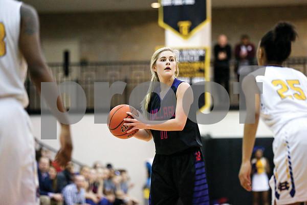 Bullard senior Abby Story (11) looks to pass the ball during a regional quarterfinals girls basketball game at Wagstaff Gymnasium in Tyler, Texas, on Monday, Feb. 20, 2017. (Chelsea Purgahn/Tyler Morning Telegraph)