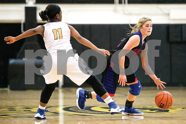 Bullard senior Abby Story (11), right,  dribbles the ball down the court during a regional quarterfinals girls basketball game at Wagstaff Gymnasium in Tyler, Texas, on Monday, Feb. 20, 2017. The Bullard Lady Panthers beat the Chapel Hill Lady Bulldogs 54-36. (Chelsea Purgahn/Tyler Morning Telegraph)