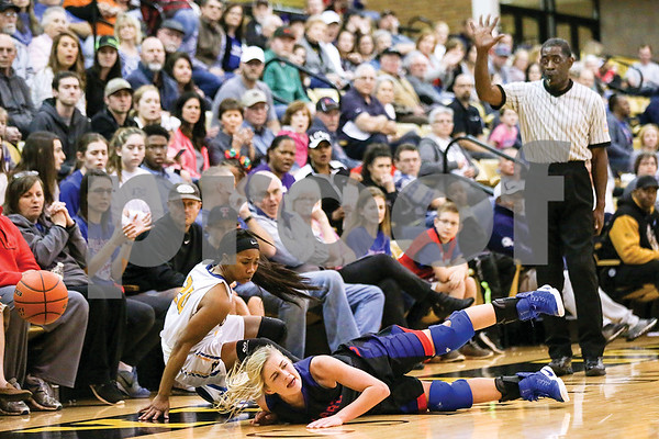 Chapel Hill senior Mikaela Alfred (20) and Bullard senior Abby Story (11) fall while trying to retrieve the ball during a regional quarterfinals girls basketball game at Wagstaff Gymnasium in Tyler, Texas, on Monday, Feb. 20, 2017. (Chelsea Purgahn/Tyler Morning Telegraph)