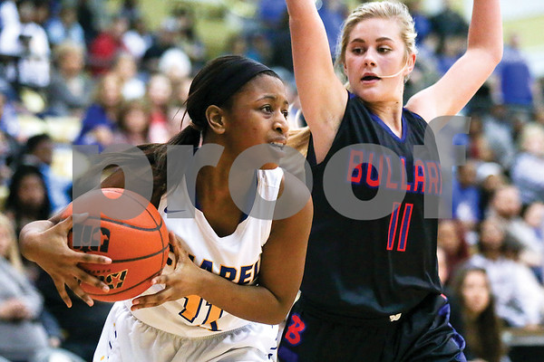 Chapel Hill freshman Natalya Overshown (11), left, looks to pass the ball during a regional quarterfinals girls basketball game at Wagstaff Gymnasium in Tyler, Texas, on Monday, Feb. 20, 2017. The Bullard Lady Panthers beat the Chapel Hill Lady Bulldogs 54-36. (Chelsea Purgahn/Tyler Morning Telegraph)
