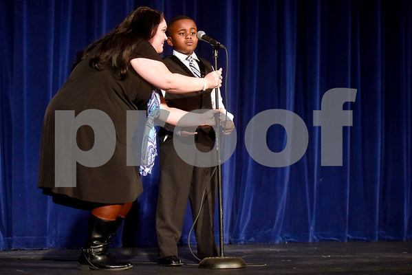 Heidi Aaron Bryant adjusts the microphone for Jonathan Martin during John Tyler High School's Celebrate Black History Month at Caldwell Auditorium in Tyler, Texas, on Tuesday, Feb. 20, 2018. Students performed songs in choirs and in a jazz band as well as monologues. (Chelsea Purgahn/Tyler Morning Telegraph)