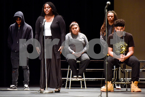 John Tyler's Thespian Troup performs Let America Be America Again during John Tyler High School's Celebrate Black History Month at Caldwell Auditorium in Tyler, Texas, on Tuesday, Feb. 20, 2018. Students performed songs in choirs and in a jazz band as well as monologues. (Chelsea Purgahn/Tyler Morning Telegraph)