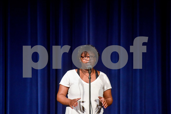 Dayezsha Lowrie performs a monologue during John Tyler High School's Celebrate Black History Month at Caldwell Auditorium in Tyler, Texas, on Tuesday, Feb. 20, 2018. Students performed songs in choirs and in a jazz band as well as monologues. (Chelsea Purgahn/Tyler Morning Telegraph)