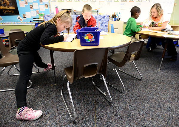 "Lily Adams (left) and Adam Regner (right) work on their stories in Jenny Chamberlain's kindergarten class at Sanchez Elementary in Lafayette, Colorado February 22, 2013.  DAILY CAMERA/ MARK LEFFINGWELL<br /> <br /> See video of kids from Emerald Elementary and Sanchez Elementary working on their stories at  <a href=""http://www.dailycamera.com"">http://www.dailycamera.com</a>"