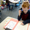 "Phineaus Cohen uses a whisper phone to proof read his story at Emerald Elementary in Broomfield, Colorado February 22, 2013.  DAILY CAMERA/ MARK LEFFINGWELL<br /> <br /> See video of kids from Emerald Elementary and Sanchez Elementary working on their stories at  <a href=""http://www.dailycamera.com"">http://www.dailycamera.com</a>"