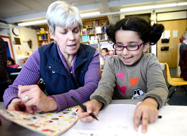 "Kindergarden teacher Lynne O'Hara (left) helps Lana Aluhaideb (right) with her monster story at Emerald Elementary in Broomfield, Colorado February 22, 2013.  DAILY CAMERA/ MARK LEFFINGWELL<br /> <br /> See video of kids from Emerald Elementary and Sanchez Elementary working on their stories at  <a href=""http://www.dailycamera.com"">http://www.dailycamera.com</a>"