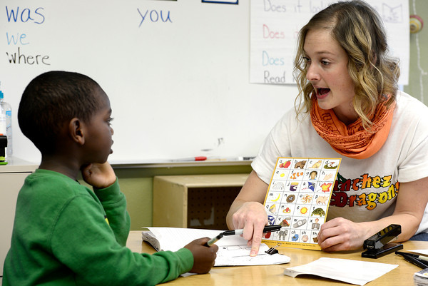 """Jenny Chamberlain (right) helps Mebratu Duckwitz (left) with his story  at Sanchez Elementary in Lafayette, Colorado February 22, 2013.  DAILY CAMERA/ MARK LEFFINGWELL<br /> <br /> See video of kids from Emerald Elementary and Sanchez Elementary working on their stories at  <a href=""""http://www.dailycamera.com"""">http://www.dailycamera.com</a>"""
