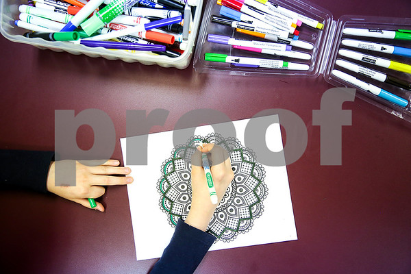 Katherine Swafford, 12, colors a mandala during art class at the Bridgemark Center in Tyler, Texas, on Monday, Feb. 27, 2017. Bridgemark Center specializes in education for children with learning disabilities such as dyslexia, dysgraphia and dyscalculia. (Chelsea Purgahn/Tyler Morning Telegraph)