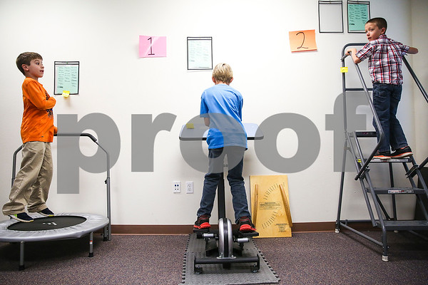 Micah Wilson, 8, Luke Petri, 10, and Austin Rutledge, 8, exercise during a physical education class at the Bridgemark Center in Tyler, Texas, on Monday, Feb. 27, 2017. Bridgemark Center specializes in education for children with learning disabilities such as dyslexia, dysgraphia and dyscalculia. (Chelsea Purgahn/Tyler Morning Telegraph)