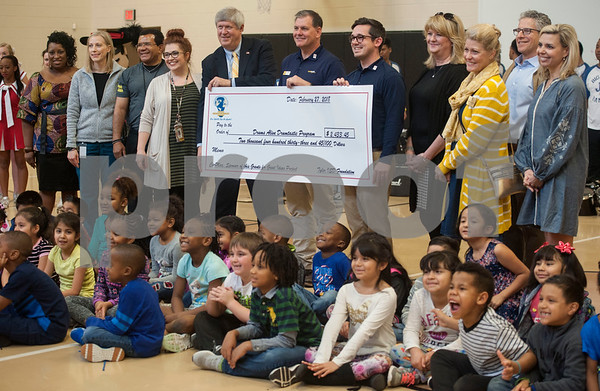 Teachers and students at Jones Elementary School take a photo with members of the Tyler ISD Foundation as they are awarded a grant for the Drums Alive Drumtastic Program on Tuesday Feb. 27, 2018. The Tyler ISD Foundation Grant Patrol visited nine Tyler ISD campuses awarding ten grants totaling more than $30,000 to support classroom learning.  (Sarah A. Miller/Tyler Morning Telegraph)